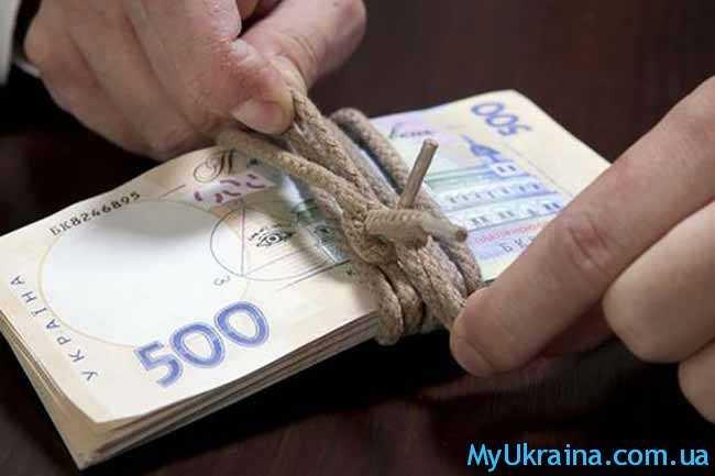 деньги,перевязанные веревкой